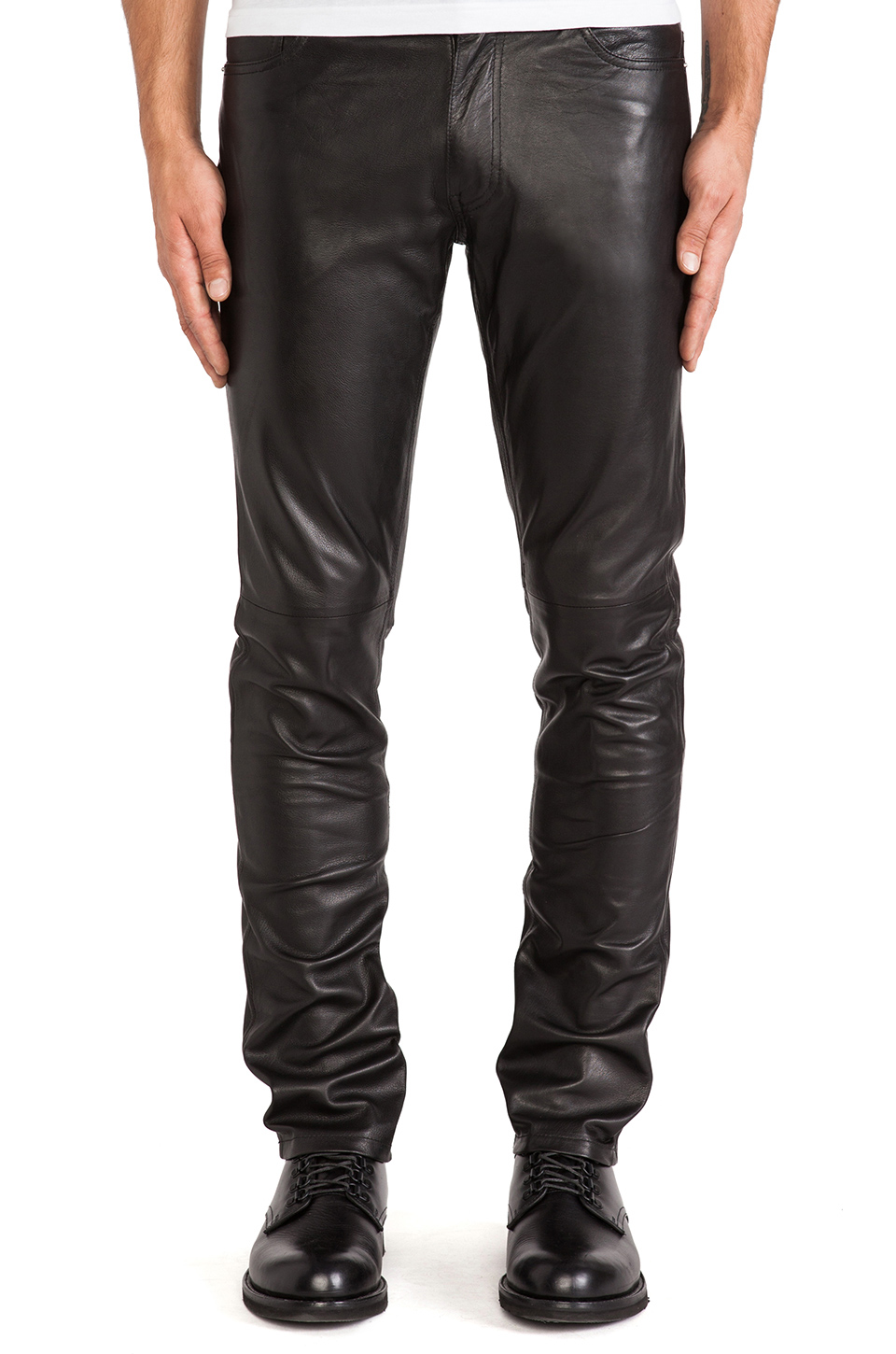 Typically, leather motorcycle pants for everyday riding or touring will be a looser fit with reinforcement panels in impact areas. As a corollary, sport riding and track pants will have more aggressive fit and pre-shaping (sewn riding position) as well as articulated stretch panels, areas for .